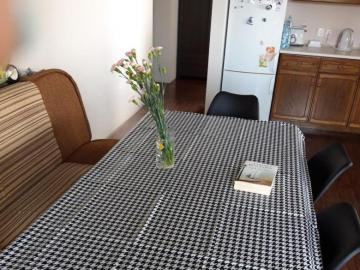 Oilcloth table with black and white pattern. - Oilcloth table with black and white pattern.