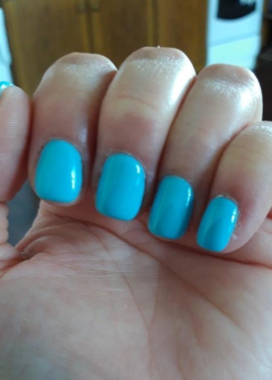 Manicure, unghie blu.