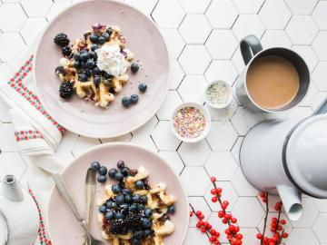 A delicious breakfast - Tasty breakfast. Waffles with whipped cream and blueberries