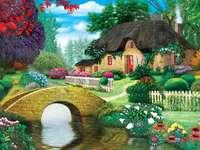 Kunyhó a patak mellett. - Színes kép. Víkendház a patak mellett. Fekvő. Színes kép.