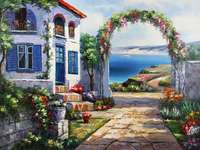 Chata s květinami u moře