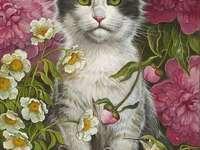 Kotki pośród kwiatków - Dwa kotki siedzące w kwiatowym ogrodzie