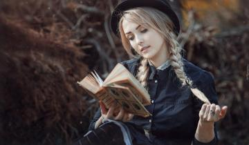 blonde with braids reading a book - blonde with braids reading a book