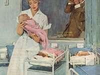 Fotograf a sestřička s novorozenci