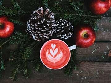 Cozy Christmas coffee - Red coffee latte on white ceramic mug. UK