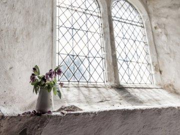 Floral vase on the window - Green and purple petal flowers on white vase near window. Tunbridge Wells, UK