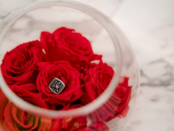 Ring by AKINGSNY - Red flowers in clear glass bowl. New York