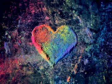 Chalk dust rainbow heart - Green and red heart shaped textile. New Hampshire, USA