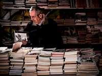 Elderly man in a bookstore