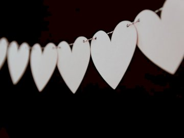 Heart Strands - Closeup photo of white heart bunting. Boston