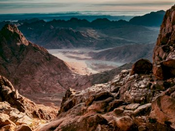 Awesome sunrise on Sinai mount - Aerial photography of desert under blue and white sky during daytime. Ukraine