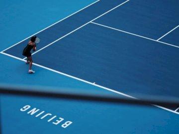 Giocatore di tennis giapponese (Cina - Donna che gioca a tennis.