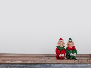 I needed a stock photo of the - Two elf on the shelf figurines.