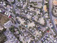 Chaos, vehicles - Aerial photography of road and houses. Germany