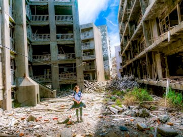 Gunkanjima is an abandoned - Woman wearing white and green dress surrounded by storey buildings. Tokyo, Japan