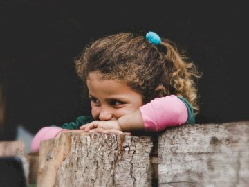 Laughter is the shortest - Girl leaning on wood log. iran