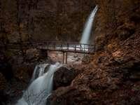 Waterfalls in Greece - Wooden bridge over flowing water.