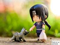 Itachi and a Poochyena - Returning from his grocer's shopping, Itachi meets a poochyena