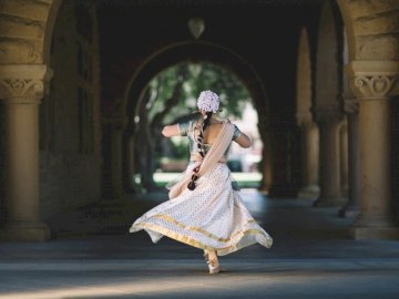 In ancient northern India, - Woman running on hallway. San Francisco