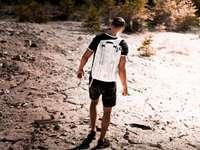 MAN ON MARS - Man walk on dry soil during daytime. Sweden