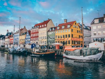 Nyhavn as a canal and street in the center of Cope - Nyhavn, the center of Copenhagen. Denmark. As a street in the center of Copenhagen, located between