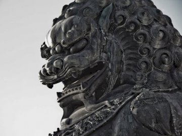 Forbidden City, Beijing China - Grey concrete fu dog statue. Los Angeles