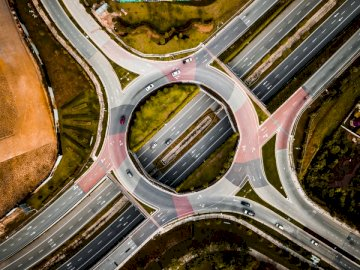 I was taking photo of a park - Aerial photography of vehicles running on vehicle intersection route at daytime. Malaysia