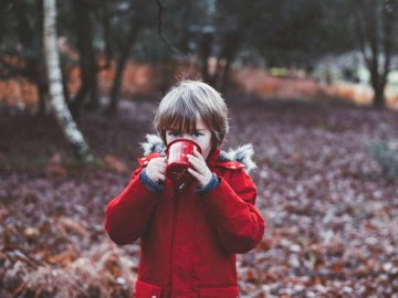 Ozzy, for kids - Photo of child drinking using cup outdoors during daytime. New Forest National Park, UK