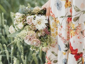 The flowers are beautiful - Woman holding a bouquet of flowers