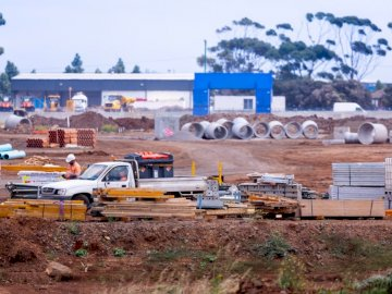 Roads Construction Site. - Yellow and white sedan on brown field during daytime. Melbourne, Australia