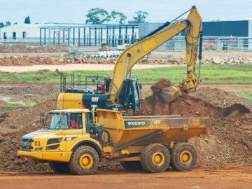Heavy vehicles at work at - Yellow and black UNK loader. Melbourne, Australia