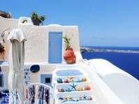 Aegean sea in Santorini, Greece - Traditional white painted house with Aegean sea view in Santorini, Greece