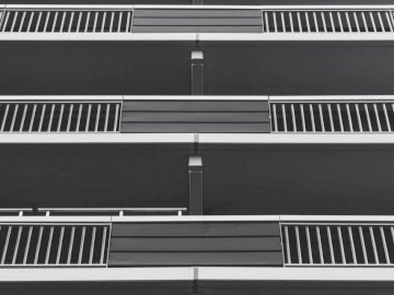 Monochrome flat balconies - Three stainless steel 3-storey building terrace rails. The Netherlands