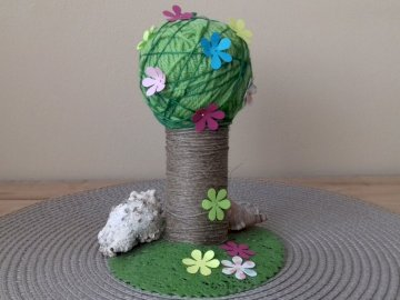 Invite spring to yourself - Mini spring home decoration. A stuffed animal sitting on a table.