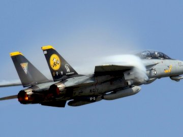 F 14 tomcat - sonic boom F 14 tomcat. A fighter jet flying in the air.