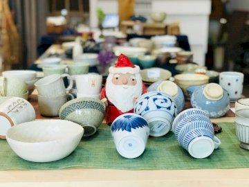 Chrismas - White ceramic snowman figurine on table. Taiwan.