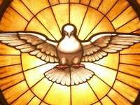 Pentecost - picture of the Holy Spirit. A close up of a metal bench.