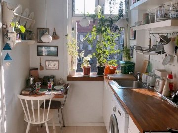Small kitchen - a small kitchen with a window. A kitchen with a dining table.