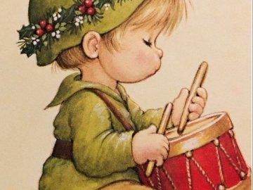 náš malý bubeníček - náš malý bubeníček. Un bambino seduto su un tavolo.