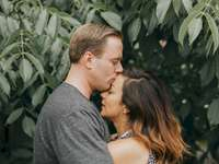 Another photo from the shoot - Couple hugging near tree leafs.