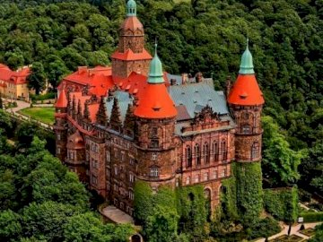 Ksiaz Castle. - Puzzle: Ksiaz Castle. A castle on a train track with trees in the background.