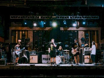 #soundcheck - Band performing on stage. Miami, Florida. A group of people performing on stage in front of a crowd.