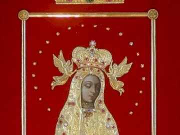 Mother of God - image of Our Lady of Licheń. A person posing for the camera.