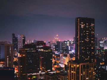 Bangkok from the rooftop at - City skyline during night time. A view of a city at night.