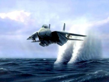 F-14 Tomcat - f-14 sonic boom water column. A plane flying in the air with smoke coming out of the water.