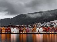 landscape - Bryggen, Bergen, Norway. A bridge over a body of water with a mountain in the background.
