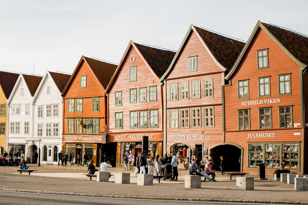 Bergen, Norway - Bergen, Norway, photo. A close up of a street in front of a house with Bryggen in the background.