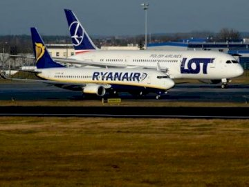 we are flying by plane - Do you want to travel? We fly!. A large passenger jet sitting on top of a runway.