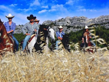Sebastian - Riders of Le Petit Roman Ranch in Maussane les Alpilles. A group of people standing on top of a dry