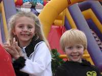 Lorna & Nathan - At the lemon festival in Menton. A young child smiling at the camera. With flowered Corso from Mento